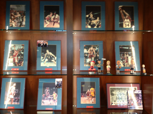 Some photos – and bobbleheads! – are already decorating the shelves outside the offices.