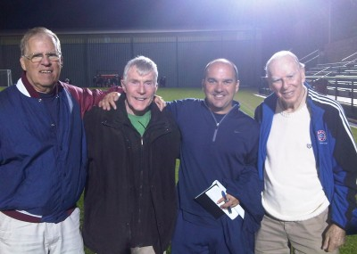 Rudy Fuller, second from right, poses with Charley Scott, right, as well as former soccer coaches Bob Seddon, left, and George O'Neill.