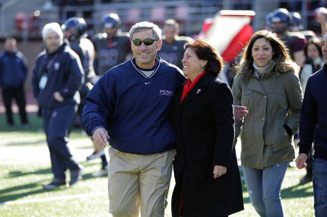 Bagnoli walks with his wife Maryellen during a pregame tribute to him Saturday.