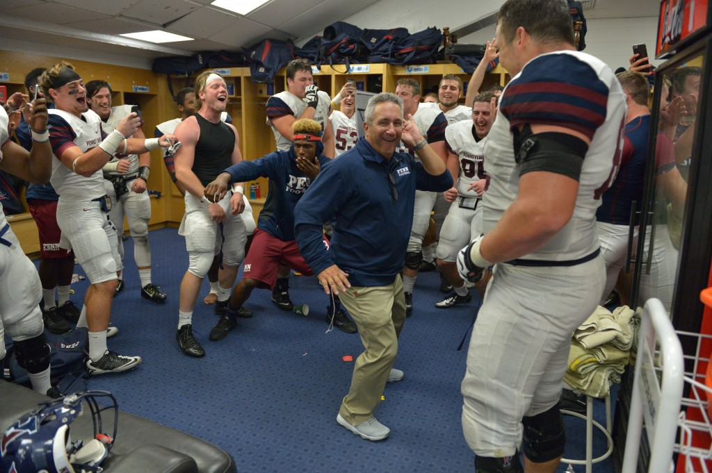 Penn head coach Ray Priore dances in the locker room after the Quakers' win Thursday (Penn Athletics).