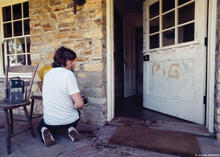 Roman Polanski outside his Cielo Drive home, days after the Manson Family murdered his wife, actress Sharon Tate (1969, Life).