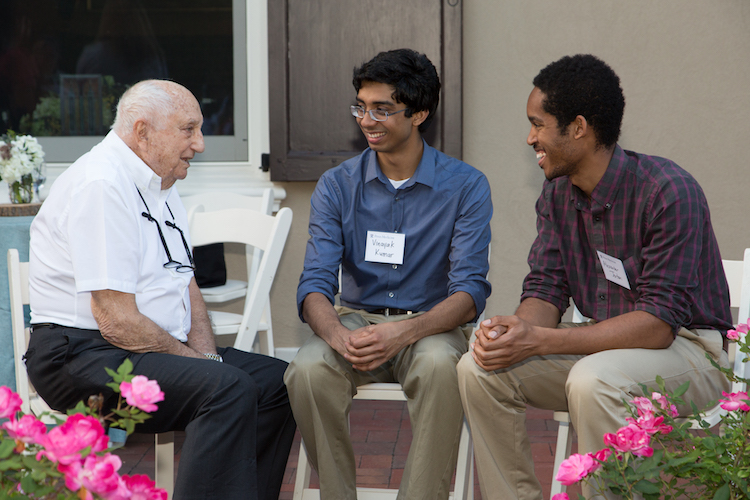Ray Perelman chats with students during Dean Jameson's annual first-year student picnic, June 7, 2017.