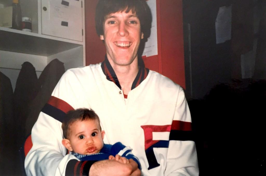 Fran McCaffery holding baby Justin.