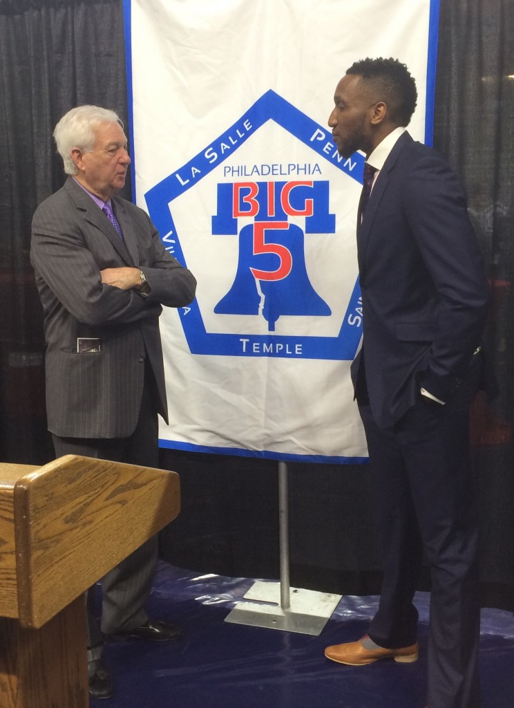 Onyewke chats with famous basketball broadcaster Bill Raftery before the induction ceremony.