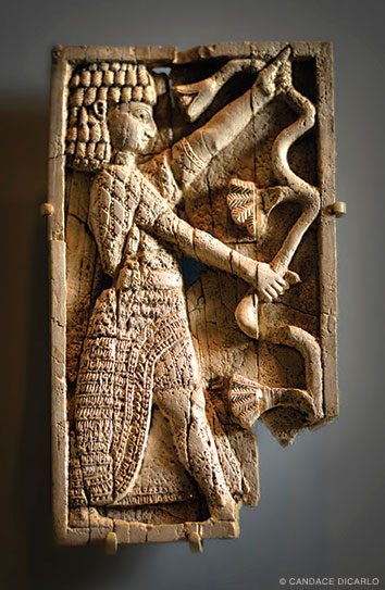 Ivory furniture plaque, eighth century BCE, probably used to decorate a chair or couch.