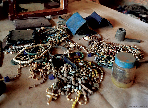 Besides clothes, materials to be conserved include rosary beads and other objects shown here on the altar in the church.