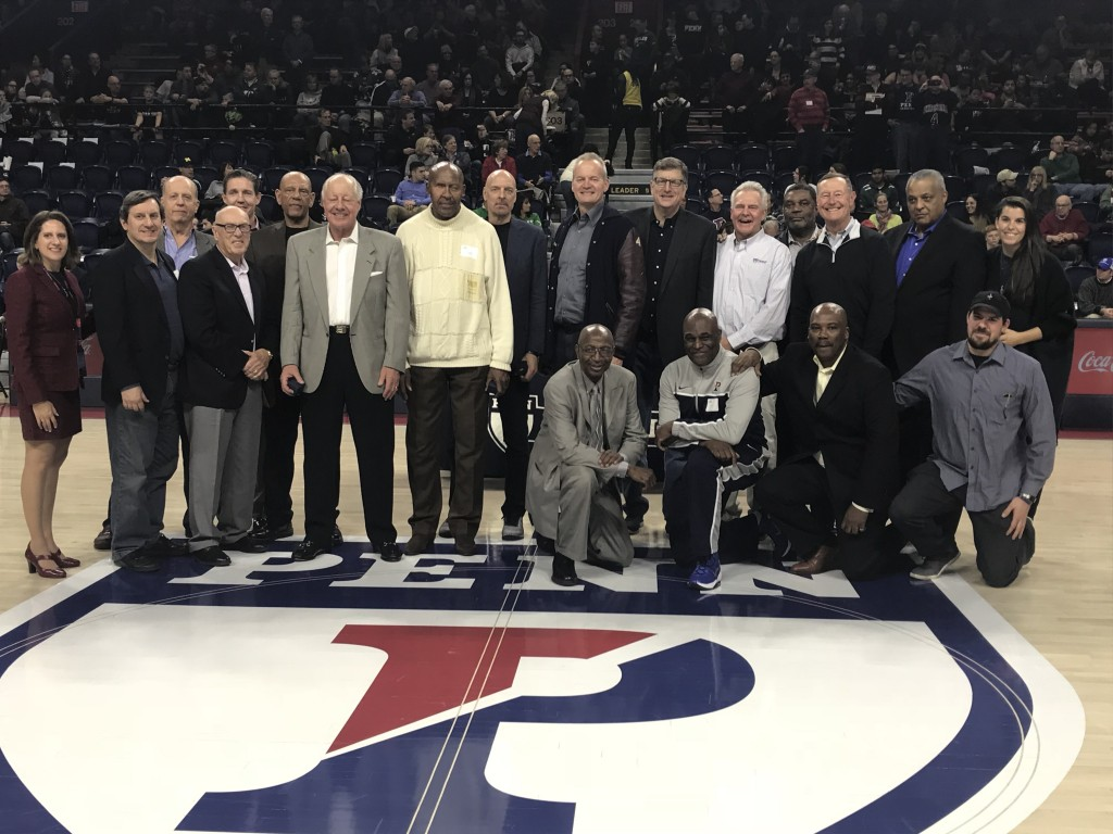 Members of the 1977-78 team pose together during a halftime ceremony.