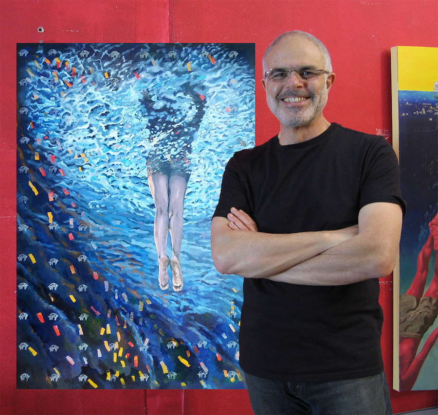 Marcos stands with one of his paintings of a girl in water