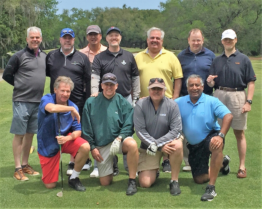 1980s King's Court/English House alumni pose on the green during a golf outing.