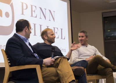 Rabbi Mike Uram, Steven Cook W'95, and Michael Solomonov sit on a panel discussion at Penn Hilell.