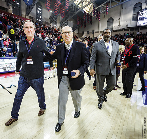 Weinhauer flanked by former student manager Peter Levy W'82, left, and Tim Smith.