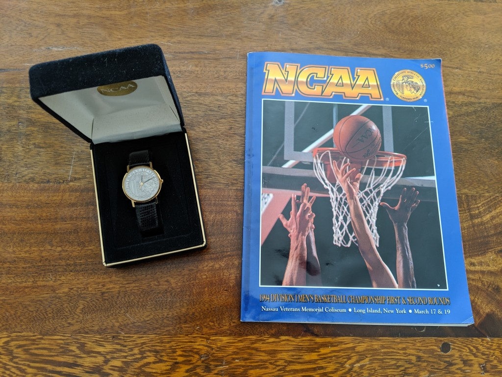 A 1994 NCAA Tournament program and ring given to participants (courtesy of Tim Krug).