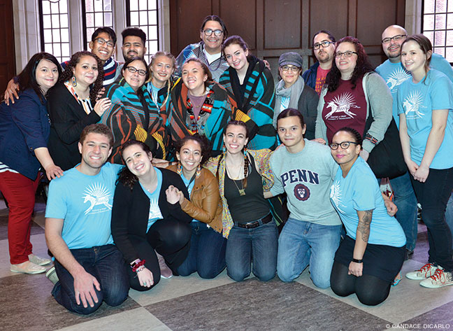 Photo of NAP students, alums, and mentors pose for a photo during this year's Powwow at Houston Hall.