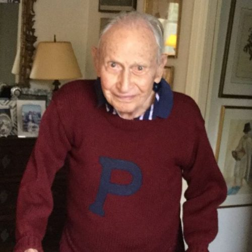 100-year-old Howard C. Story wearing a maroon Penn sweater