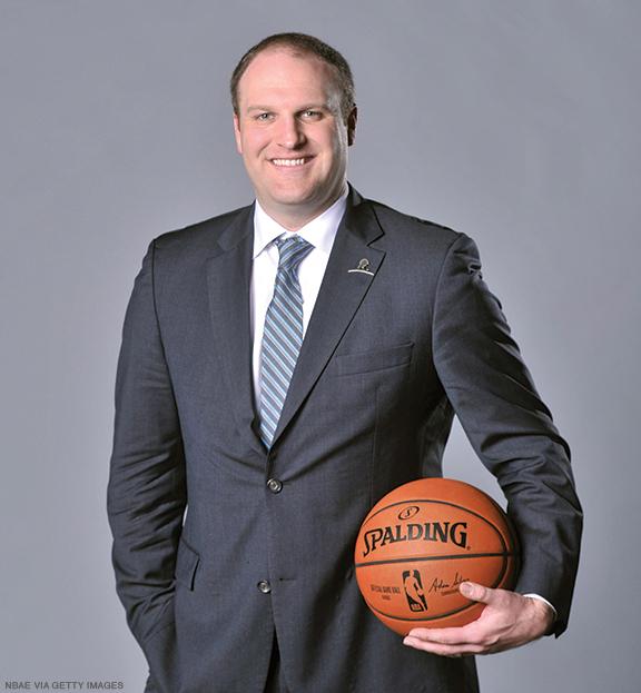 Photo of Taylor Jenkins holding a basketball