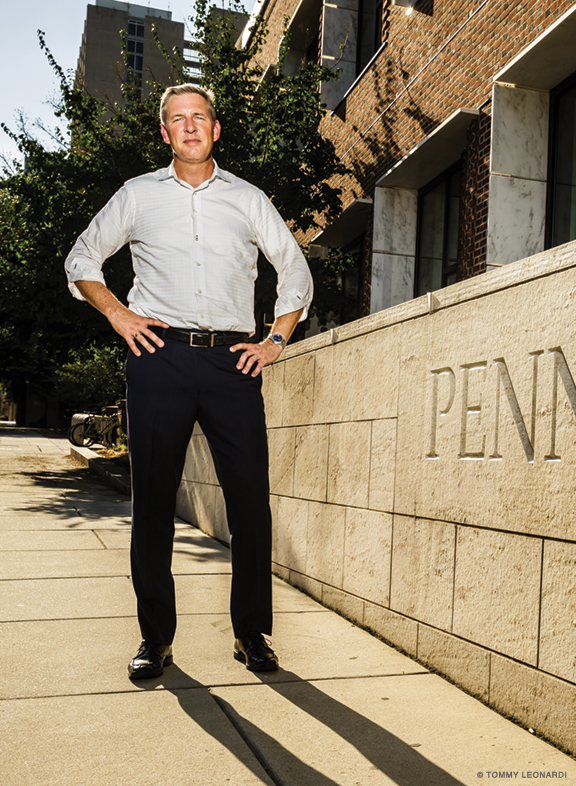 Photo of John Hollway standing outside of Penn's law school