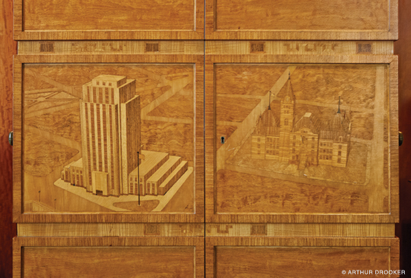 Cabinet depicting St. Paul City Halls, new and old. Photo by Arthur Drooker.