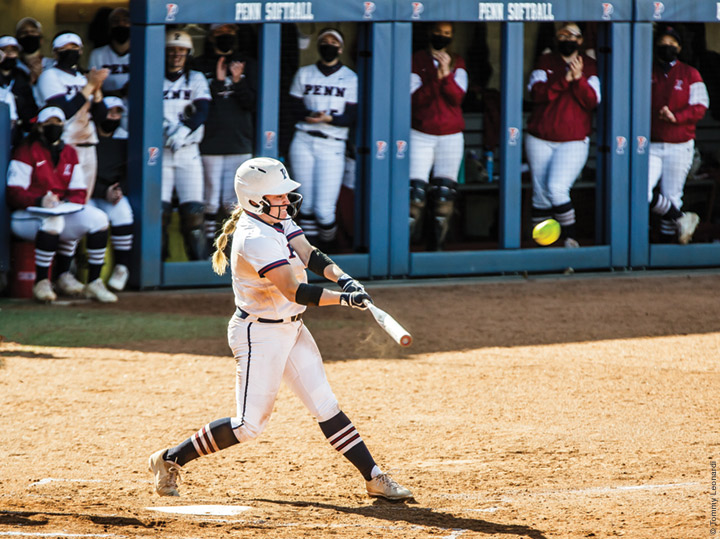 Photo of Emma Nedley connecting on a three-run home run during Penn's softball doubleheader sweep of St. Joe's on April 3.