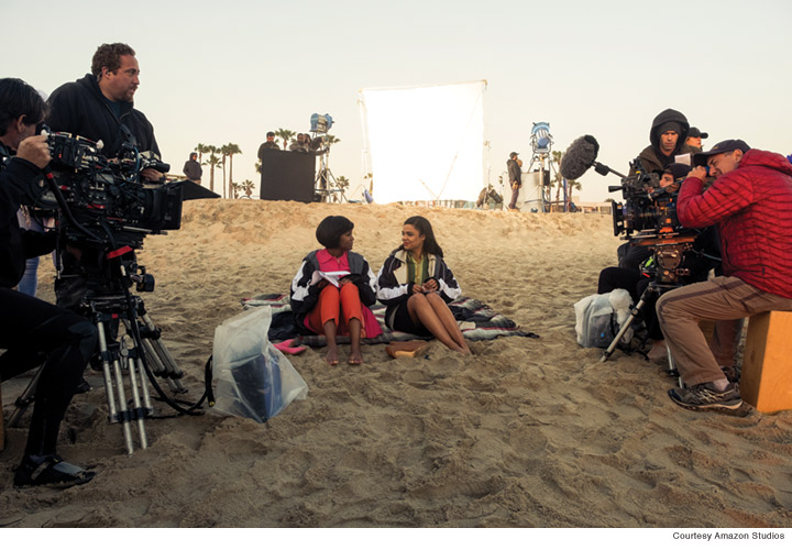 Photo of a beach scene during the making of Sylvie's Love.