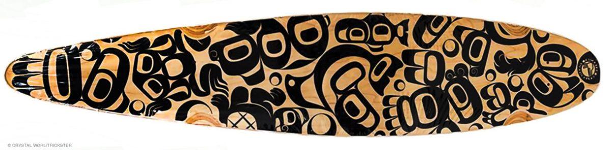 A Trickster Rainforest Party skateboard blends formline motifs with Japanese Chibi influences.