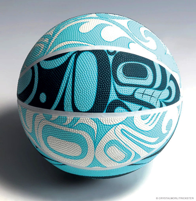 A Trickster women's basketball featuring traditional Northwest Coast formline depictions of aquatic life.