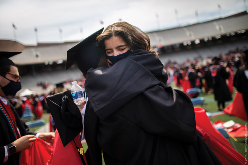 Photo of two graduating seniors hugging at Penn commencement 2021