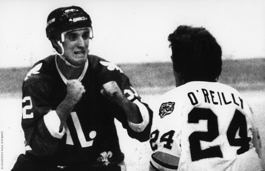 Photo of hockey player Paul Stewart gearing up for a fight on the ice.