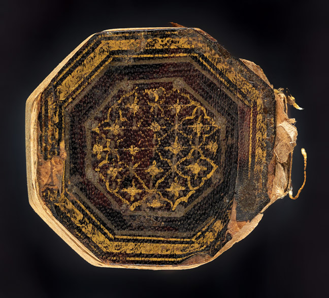 Miniature, octagonal Qur'ān, nearly complete, likely used as an amulet. The leaves were probably numbered when the copy was out of order; then it was rebound in the correct order, causing the foliation to be out of sequence. 1800.