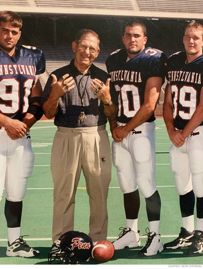 Photo of Coach Lake showing off his Ivy League championship rings.