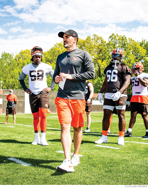 Photo of Stefanski on the field with players during 2021 training camp