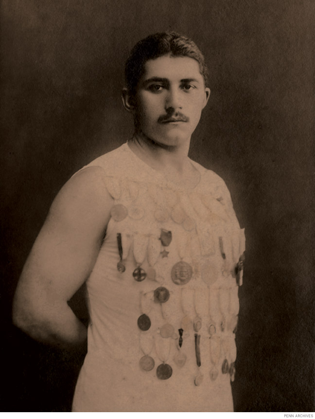 """Photo of Michail """"Mike"""" Dorizas wearing numerous medals"""