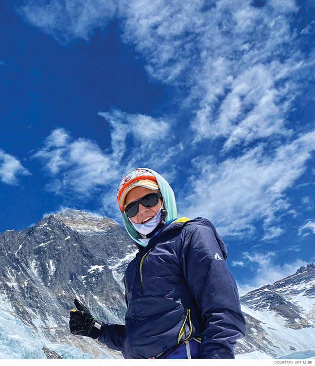 Photo of Art Muir giving the thumbs up on his way up the mountain